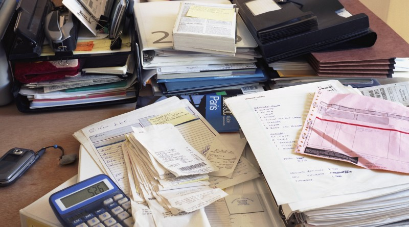 Desk with financial documents --- Image by © Adam Friedberg/Corbis