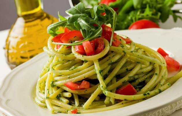 CYXMWA photo of delicious pasta with arugula pesto and cherry tomatoes